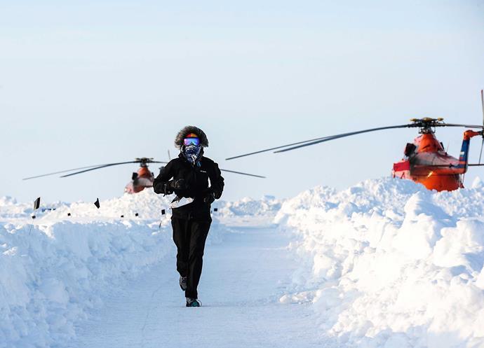 Heather running the North Pole Marathon in 2015.