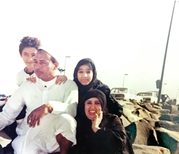 Manal and brother Muhammad with their parents.