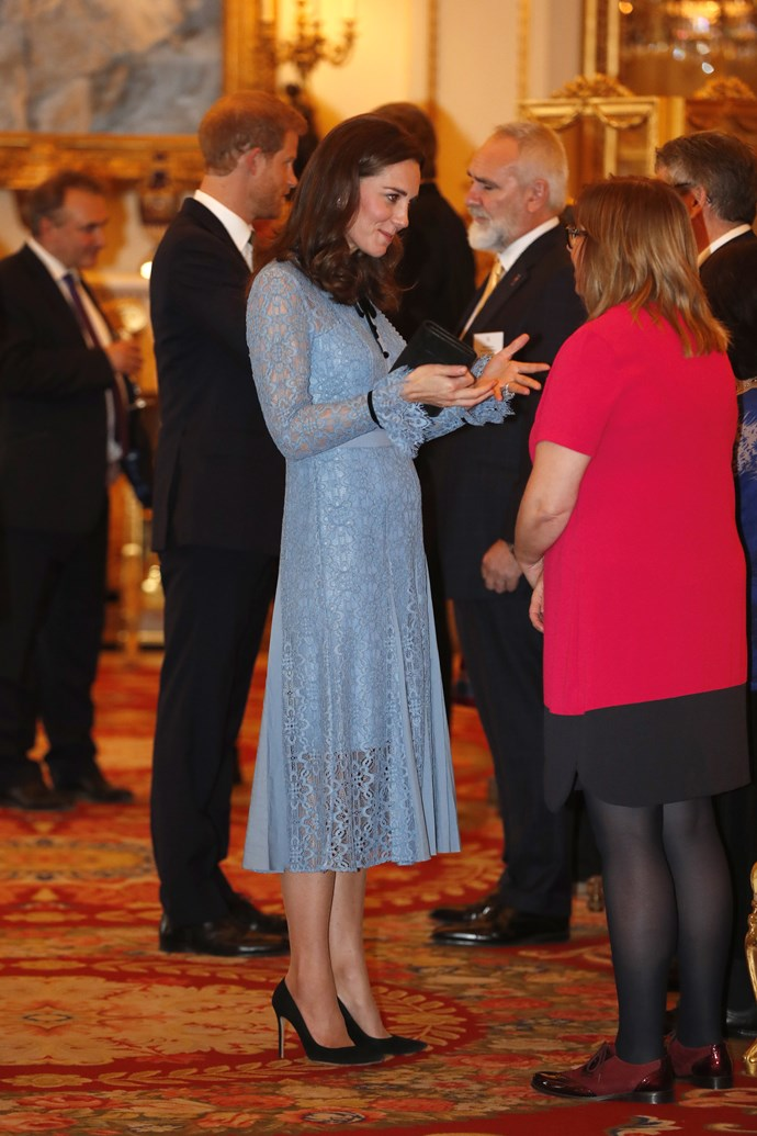 The Duchess' tiny baby bump is starting to show.