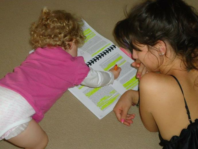 Studying with baby Alexia.