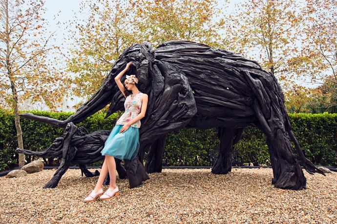 Giant-flower accessories are an easy nod to the trend without breaking the bank.                                                    *Top, $219, by Isaac & Lulu. Skirt, $295, and headpiece, $295, by Natalie Chan. Necklace, $499, by La Source. Loafers, $415, by Karen Walker.*