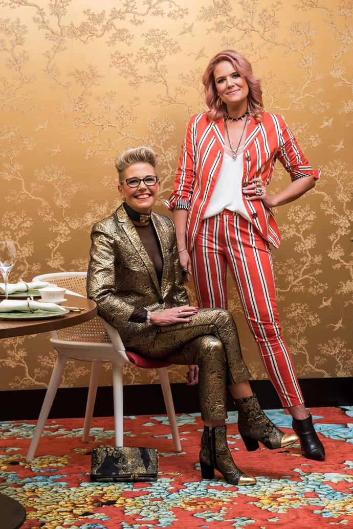 """""""We like the same things,"""" says Lizzie (left), """"but I love how if we choose to buy the same item, we'll wear it totally differently."""" Lizzie wears suit, boots and bag by Zadig & Voltaire, bodysuit from H&M and choker by Silk & Steel.  Julia wears suit by Cooper, camisole by Aritzia, earrings by Partridge Jewellers, heirloom bangle, originally given to Lizzie (worn throughout) and boots by Kathryn Wilson."""