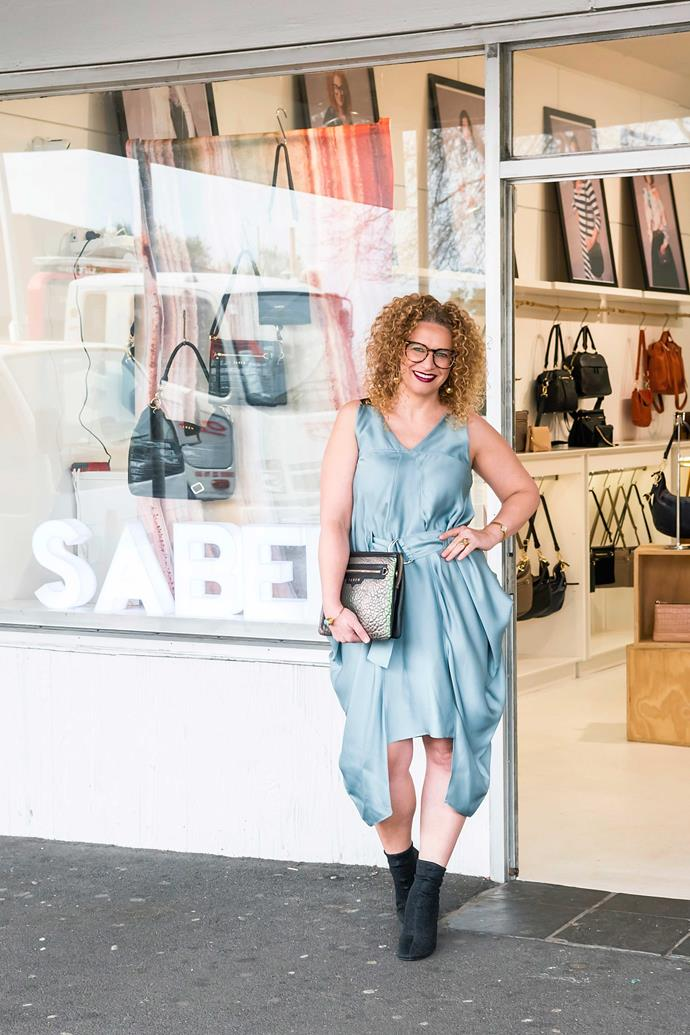 Dress by Taylor, boots by Céline, glasses by Gentle Monster, and earrings, clutch and bangle by Saben.