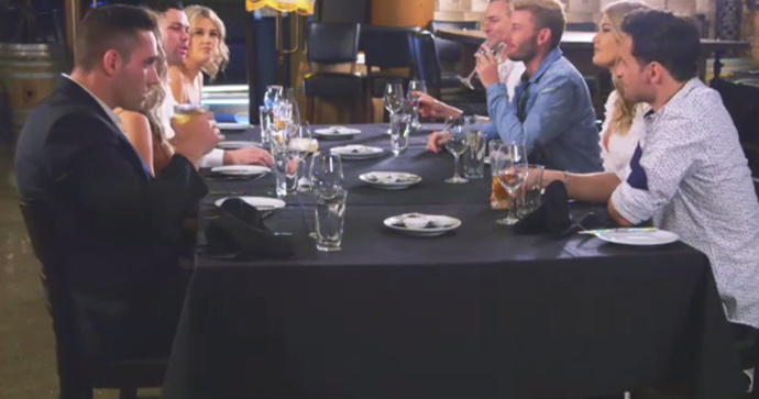 The couples sat down at the dinner party.