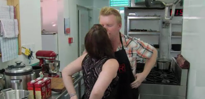 Chris and Bex share a quick kiss before jumping into their cooking.