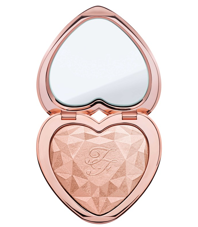 "Too Faced Love Light Prismatic Highlighter in Ray of Light                                                                                                                                                                                 ""For high-impact cheeks, use a strong metallic champagne shade like the Too Faced Love Light Prismatic Highlighter in Ray of Light ($47) on the tops of your cheeks and the browbones,"" says Tomlinson."