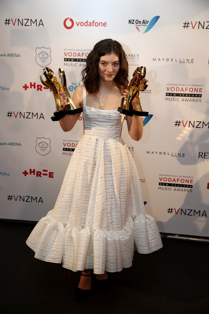 Lorde with her awards