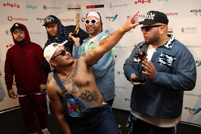 Rap group Swidt pose with their awards