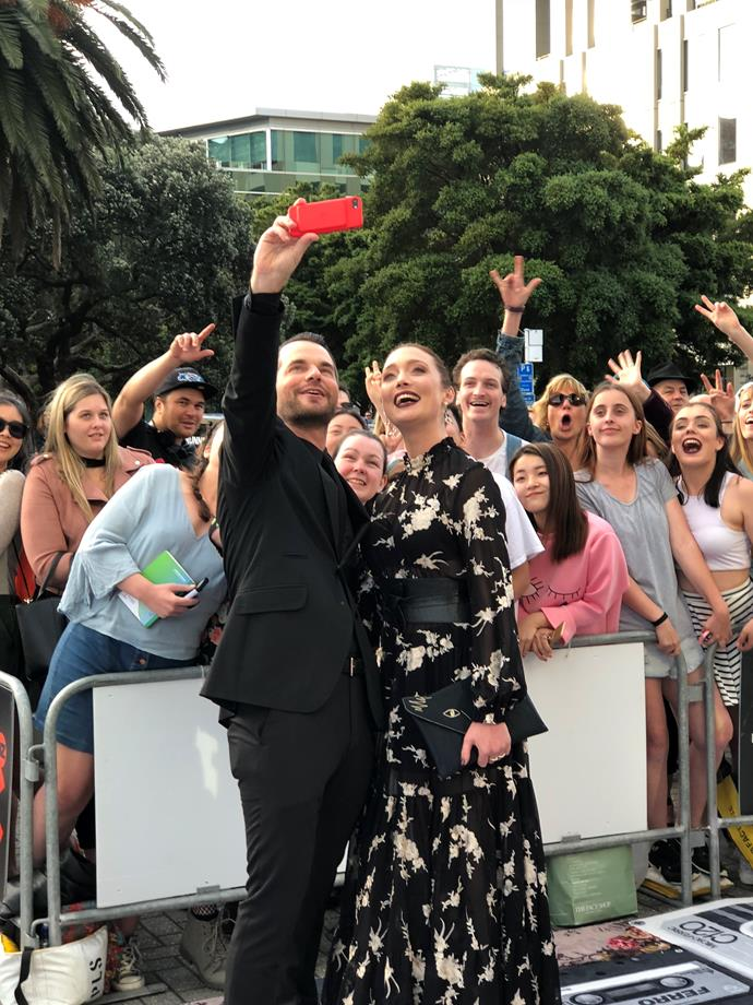 David de Latour and Antonia Prebble pose for a selfie with fans