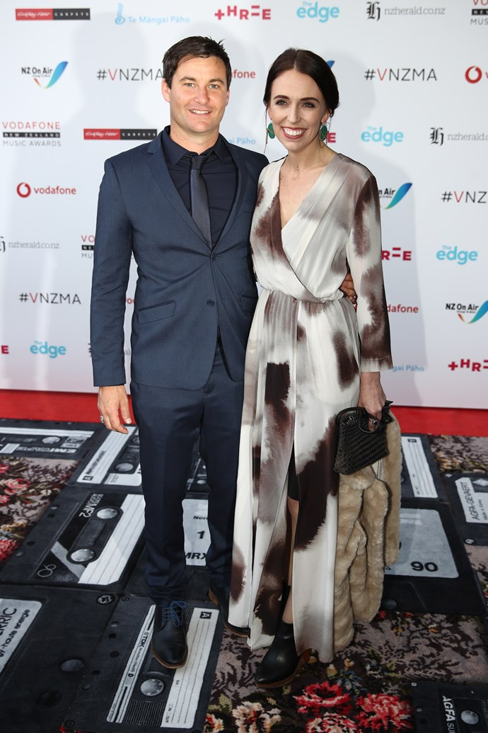 Jacinda and her partner Clarke Gayford with the Save Mart coat in hand.