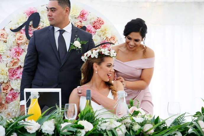 Bridesmaid Ann-Helen gifts her sister a flower crown.