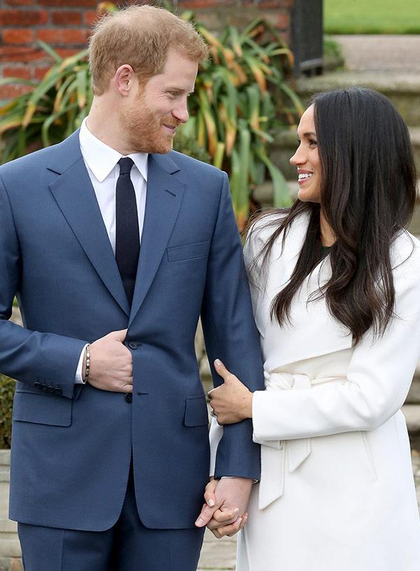 Harry nervously put his hand in his pocket but Meghan's warm embrace shows she's trying to calm his jitters.
