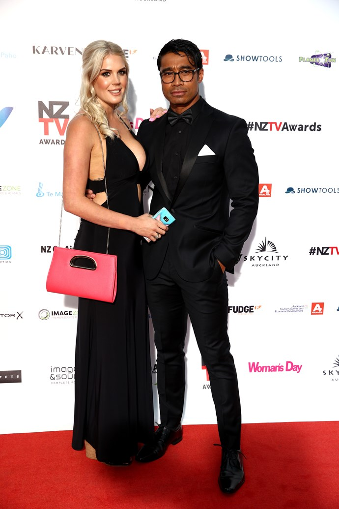 Lizz Sadler with fiance Pua Magasiva posing on the red carpet.