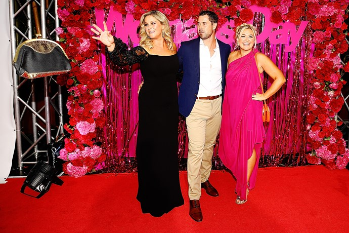 The Hits radio trio Toni Street, Sam Wallace and Sarah Gandy on the red carpet. Sam looks a little flustered as Toni uses the force to summon her bag.