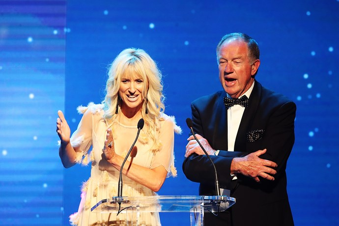 "Kate Hawkesby and her father John Hawkesby presenting an award. According to Toni Street, Kate's husband Mike Hosking was ""said he'd come but he had to wash his car""."