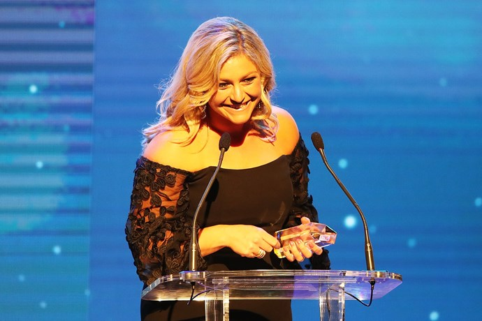 Toni Street grinning on stage as she accepts the *Woman's Day* Peoples Choice Award.