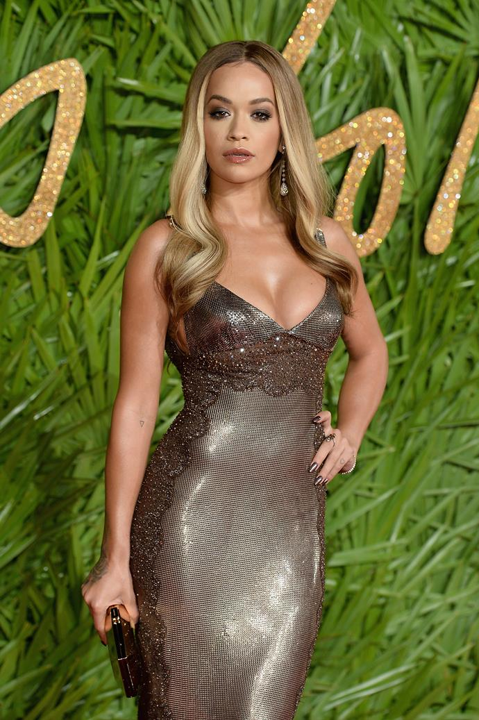 Singer Rita Ora cut an ethereal figure in a Vintage Versace chainmail evening dress.
