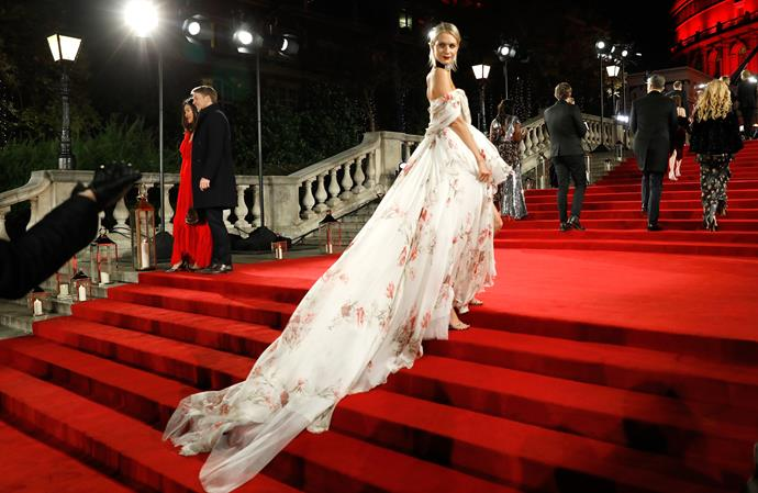 English model and actress Poppy Delevingne made a grand entrance in a Giambattista Valli Haute Couture gown.
