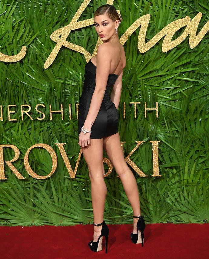 Hailey Baldwin wears little more than a belt in a custom Topshop mini dress.