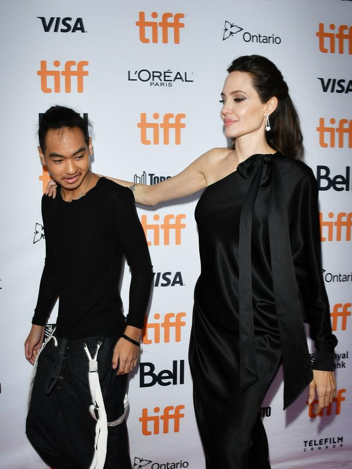 Jolie looks proudly at her son during the premiere of *First They Killed My Father*