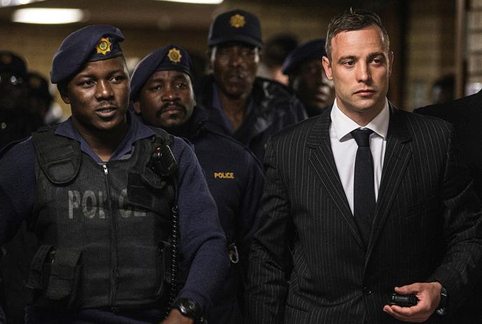Oscar Pistorious is escorted into court in 2016 for sentencing on the upgraded charge of murder.