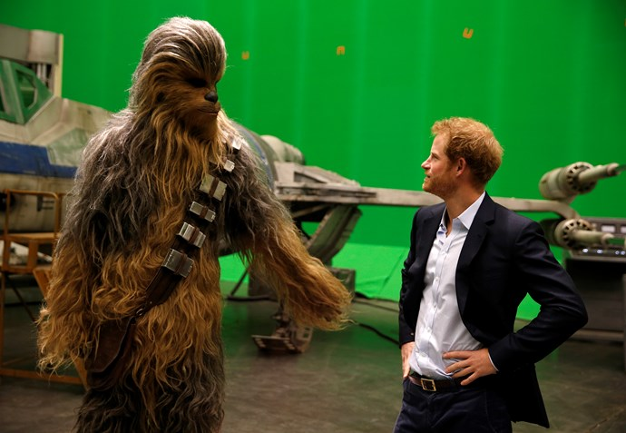 Prince Harry meets Chewbacca during a tour of the Star Wars sets at Pinewood studios in 2016.