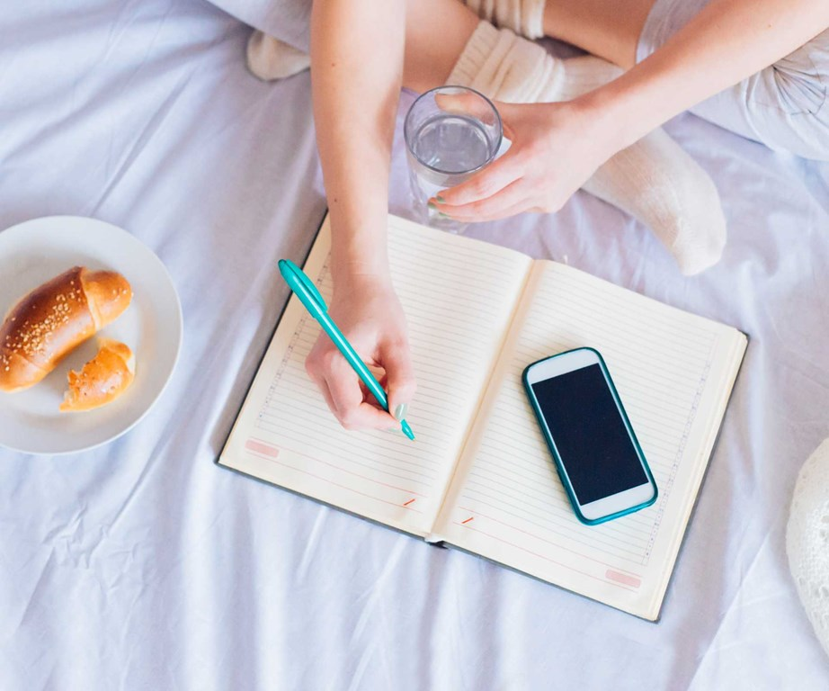 Mandi suggests keeping a journal of not just the food you eat, but also the emotions you're feeling throughout the day. *(Image: Getty)*