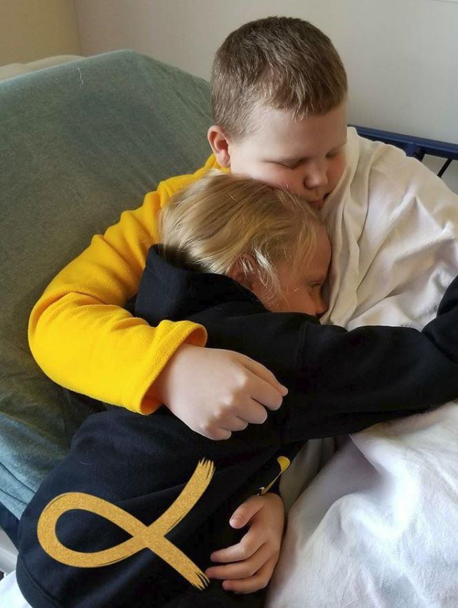 Allie with her sick brother, Robert. Picture: Kasie Muir Hart
