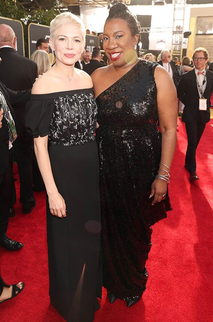 **Michelle Williams** wearing black with with civil rights activist and Time's up movement founder **Tarana Burke**.