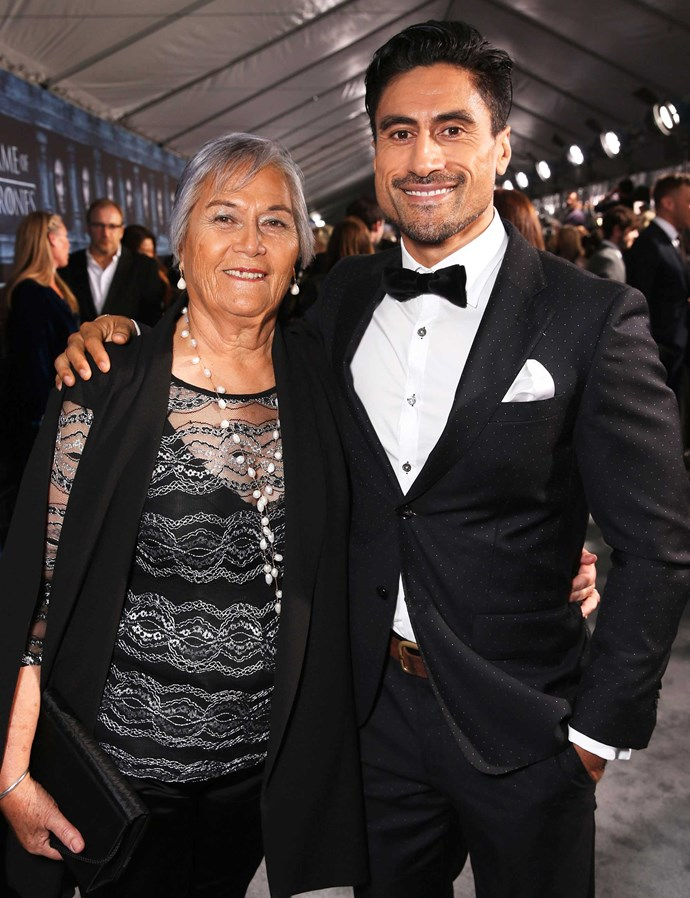 With his mum at the Hollywood premiere.