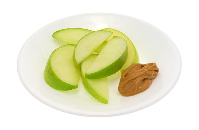 **Peanut butter slices**  Cut an apple into 6 slices and lightly spread each slice with peanut butter. It won't break the calorie bank and packs a sufficient fat and fibre punch to keep the mid-afternoon munchies at bay.