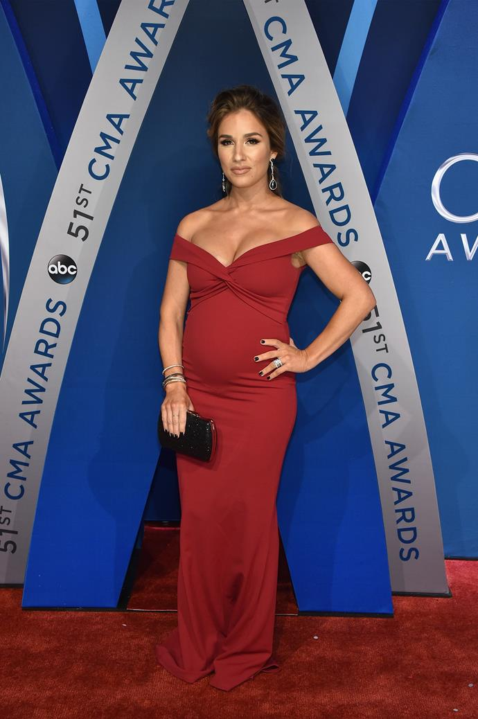 She wows in this red gown at the 51st annual CMA Awards.