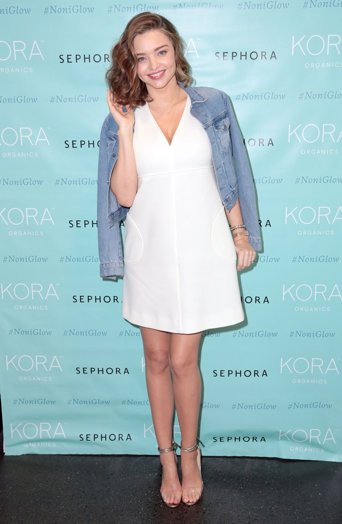 She wore this white dress paired with a denim jacket to a KORA Organics appearance in Santa Monica.
