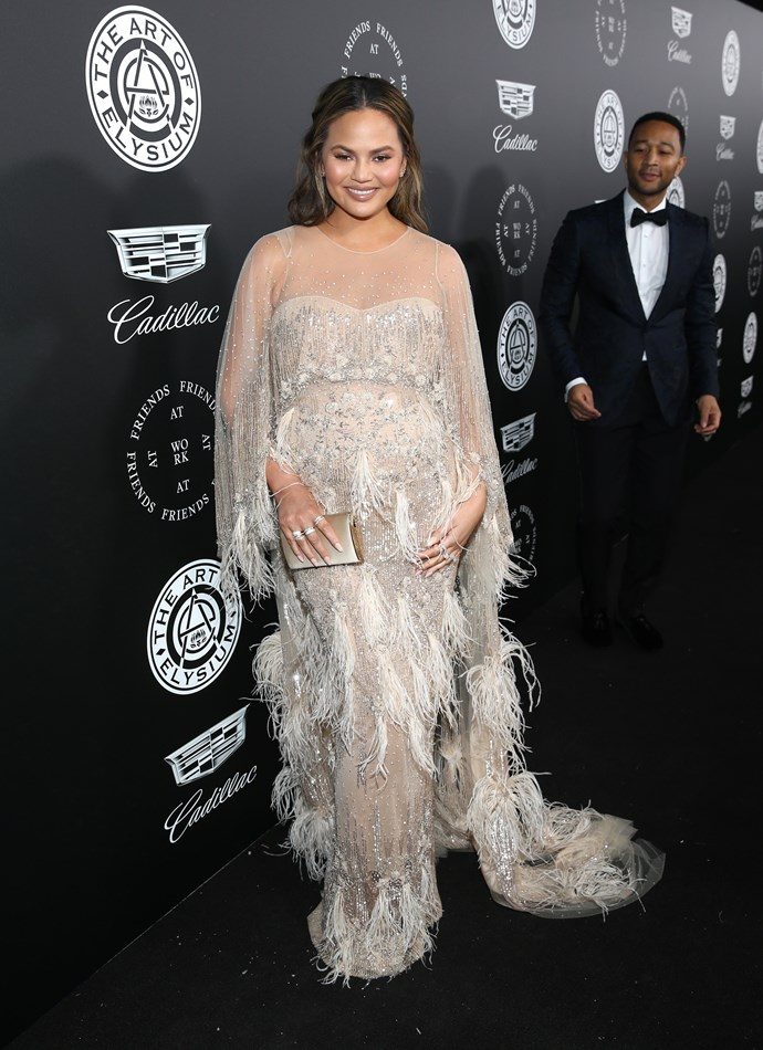 Chrissy Teigen looking glamorous in this Pamella Roland gown at The Art Of Elysium's 11th Annual Celebration. We see you admiring the view there John.