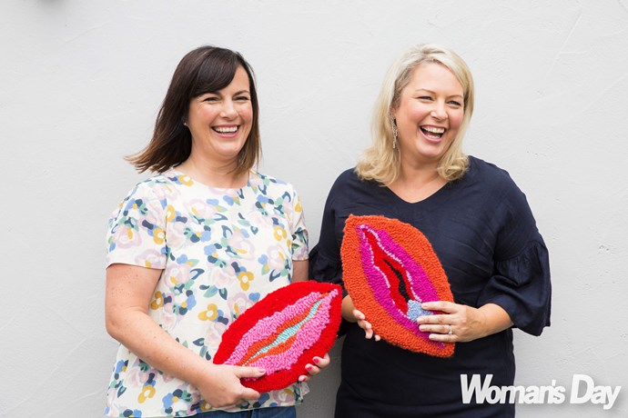 "Hello Cup creators Mary and Robyn, holding ""vagina rugs"" crafted by Evie Kemp, have no problem discussing their lady parts."