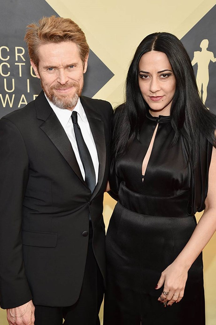 Willem Dafoe and his wife Giada Colagrande work matching black looks.