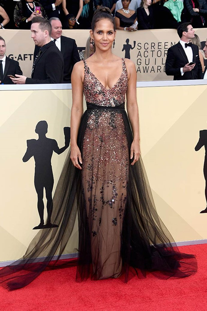 The ever stylish Halle Berry looks flawless in this plunging, sequinned dress.