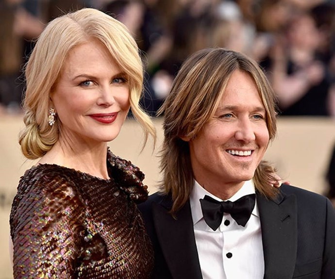And what's a red carpet without her main man, Keith Urban, right by her side.