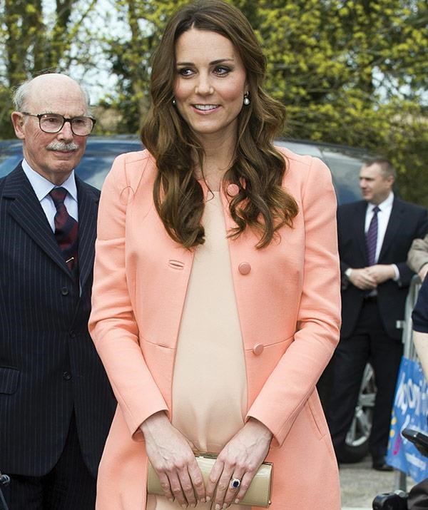Kate wore this Tara Jarmon orange outfit on her second anniversary, April 29, 2013.