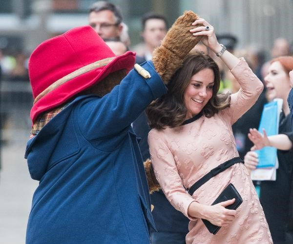 Paddington Bear spun the royal who wore a blush pink Orla Kiely dress.