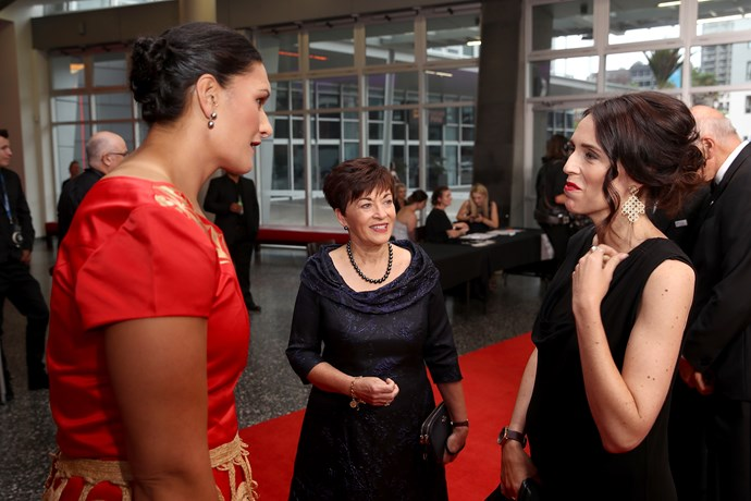 Dame Patsy Reddy has a chat with Valerie Adams and PM Jacinda.