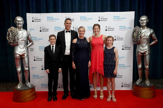 Former Olympic champion Rob Waddell looks happy with his family prior to being inducted into the NZ sports hall of fame.