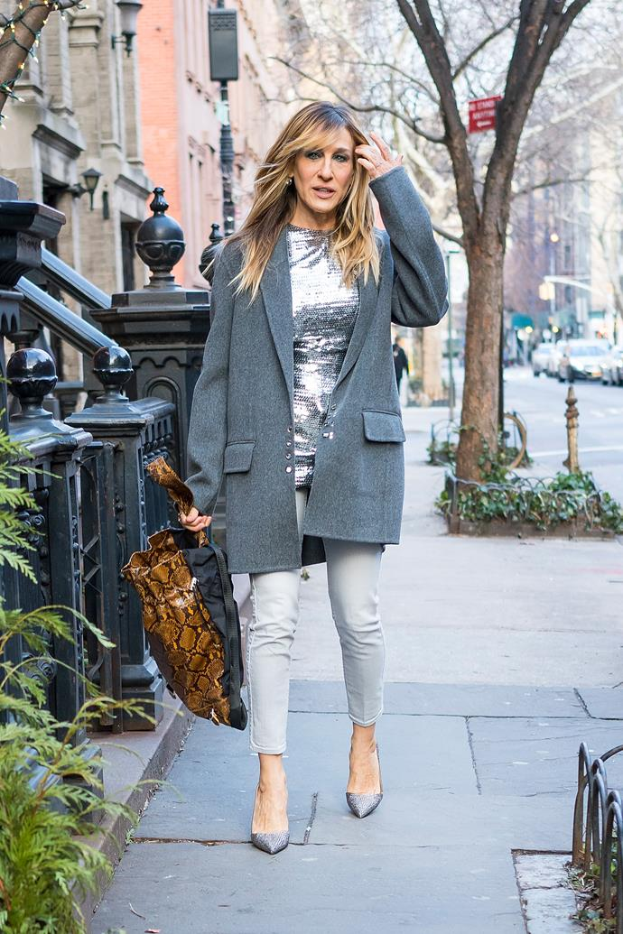 Actress **Sarah Jessica Parker** looks super chic in this grey ensemble.