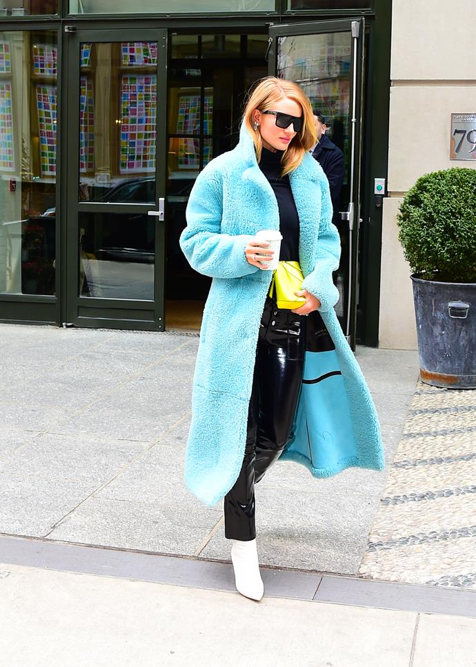 **Rosie Huntington-Whiteley** opts for a bright blue coat.