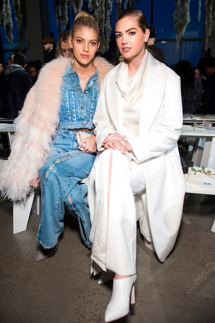 Model **Devon Windsor** (L) and **Kate Upton** sitting front row at the Jonathan Simkhai fashion show.