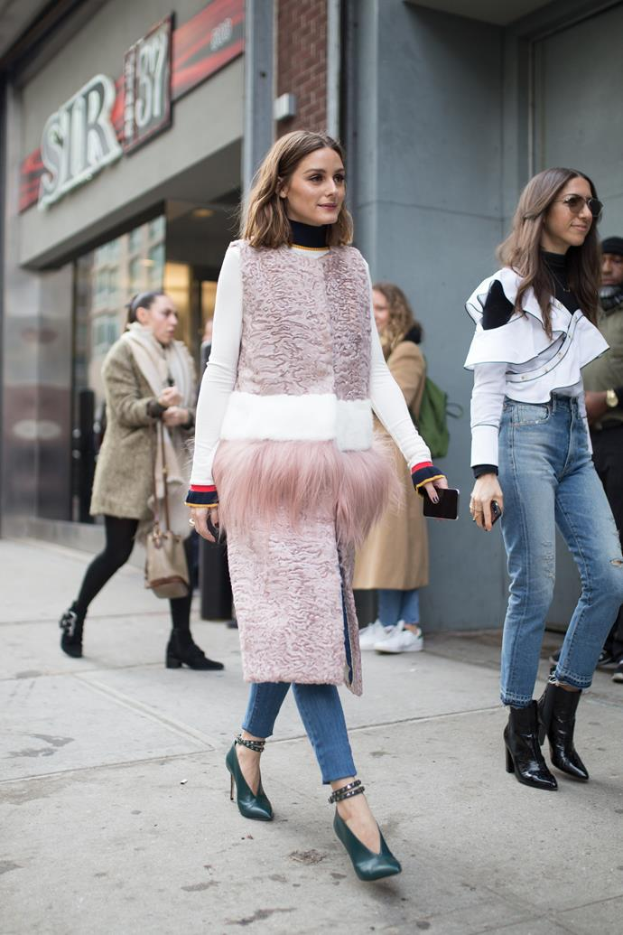**Olivia Palermo** at Self-Portrait during New York Fashion Week wearing a fur-waist coat.