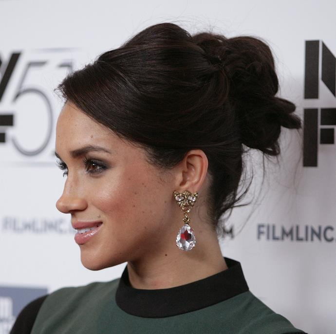 Channel your inner Duchess and emulate Meghan's chic and oh-so-classy up-do.    Credit: *Getty Images*