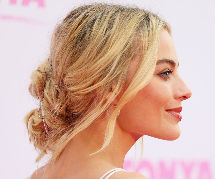 Planning a low-key beach or backyard wedding? Why not take inspiration from Margot's boho and relaxed up-do?  Credit: *Getty Images*