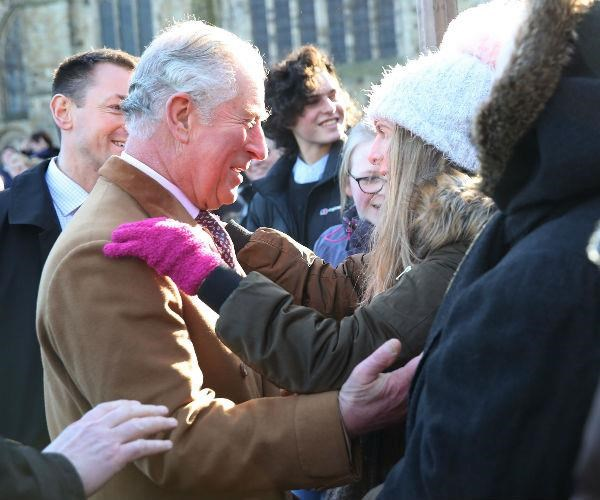 Prince Charles' security spring into action as a member of the public breaks royal protocol