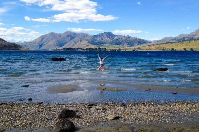 Meghan strikes a pose at a South Island lake.